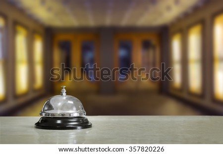 Hotel lobby with service bell and doors - stock photo