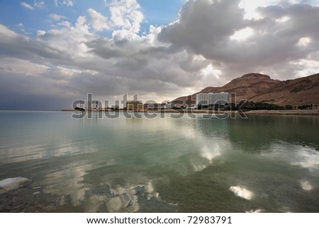 Hotel on the shores of the Dead Sea in Israel. Incredible lighting effects. Sunset. - stock photo