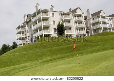 Hotel overlooking golf course - stock photo