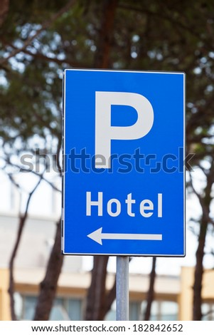 Hotel Parking Traffic Sign. Vertical shot - stock photo