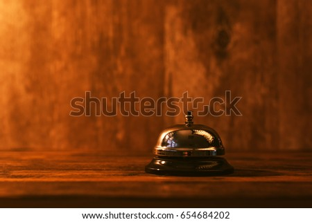 Hotel reception bell, service bell on the table, selective focus