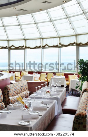 Hotel restaurant in front of great wall window - stock photo