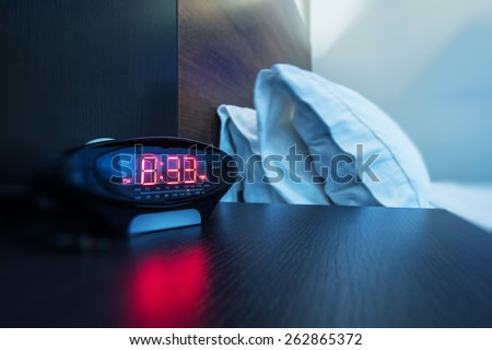 Hotel Room Alarm Clock. Waking Up in a Hotel Photo Concept. Business Travels. - stock photo
