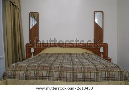 hotel room bed - stock photo