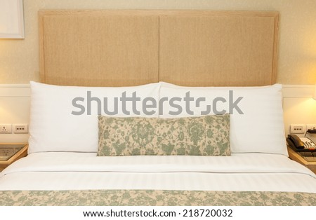 Hotel room setting with king sized bed, decorate with pillows, cover blanket, lamp, telephone in hotel Thailand  - stock photo