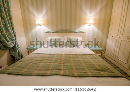 Hotel room with double bed - stock photo