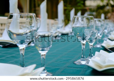 Hotel service - table in a restaurant with a blue tablecloth - stock photo