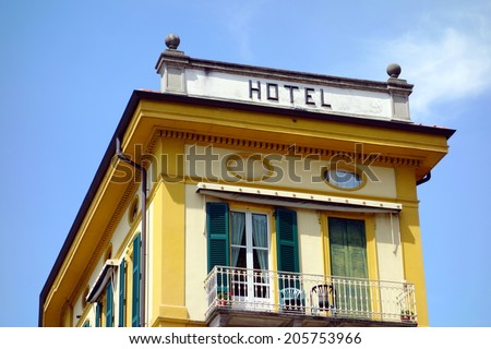 Hotel sign at the top of a building in Verenna, Italy
