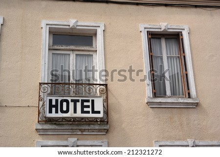Hotel sign mounted on a balcony of a building in France - stock photo