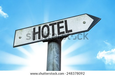 Hotel sign with a beautiful day - stock photo