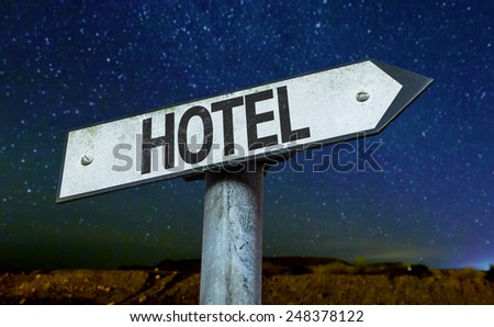 Hotel sign with a beautiful night background - stock photo