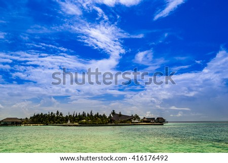 hotel view from the sea in maldives - stock photo