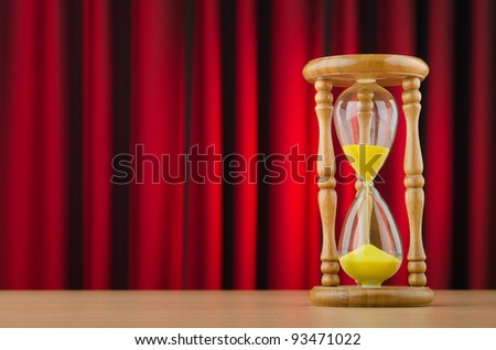 Hour glass in time concept - stock photo