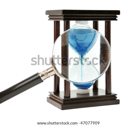 hourglass and loupe isolated on a white - stock photo