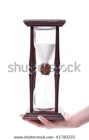 Hourglass in hand isolated on white - stock photo