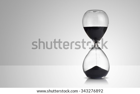 hourglass on gray background - stock photo
