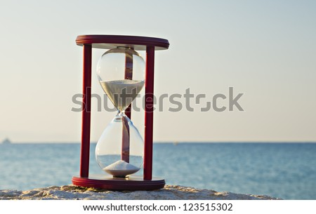 Hourglass on marine beach