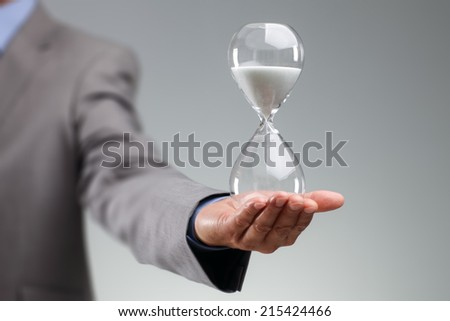 Hourglass timer concept for business deadline and leadership - stock photo