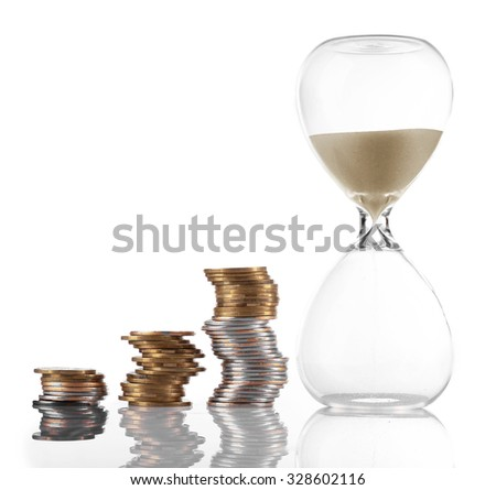 Hourglass with coins isolated on white - stock photo