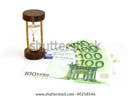 Hourglass with euro bills isolated - stock photo