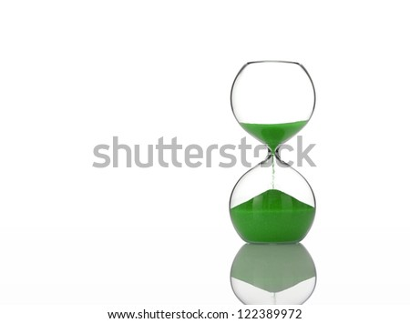Hourglass with Green Sand on White - stock photo