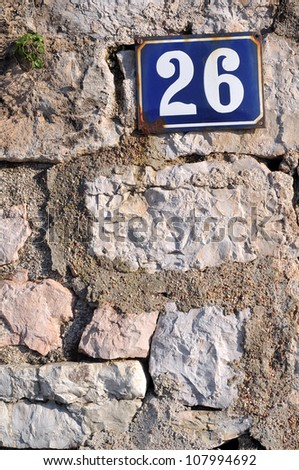 House address plate number 26 - stock photo