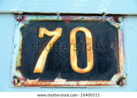 House address plate number 70 - stock photo