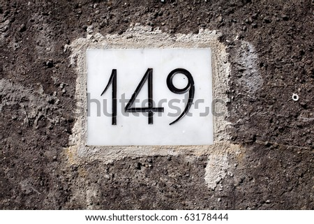 House address plate number 149 - stock photo