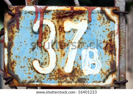 House address plate number 37B - stock photo