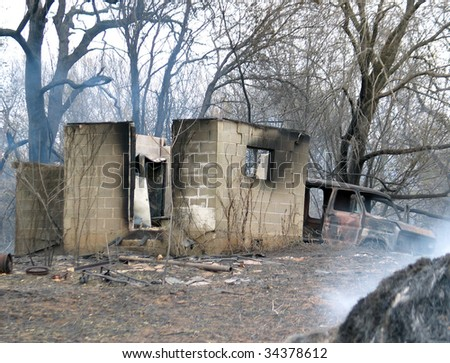 House after fire, still smoldering - stock photo