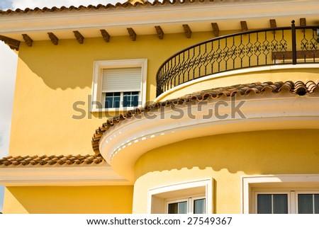 house against blue sky - stock photo