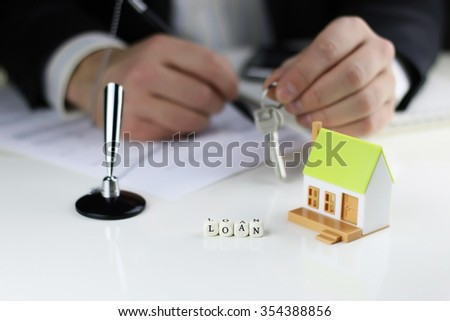 House Agents hands a contract loan mortgage - stock photo