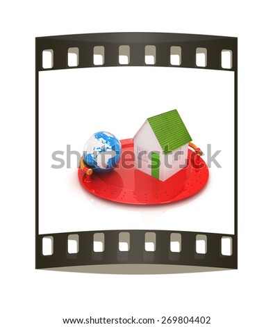 house and earth on restaurant cloche isolated on white background. The film strip - stock photo