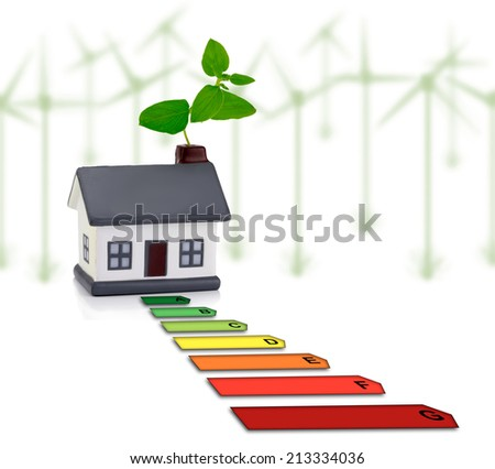 House and energy saving, energy efficiency in the home with windmill in background - stock photo