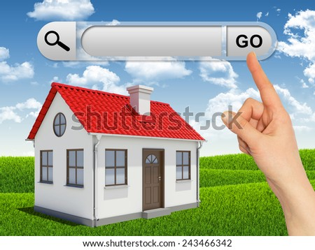 House and female hand pressing Go button at search bar above. Green lawn and sky with clowds as backdrop - stock photo