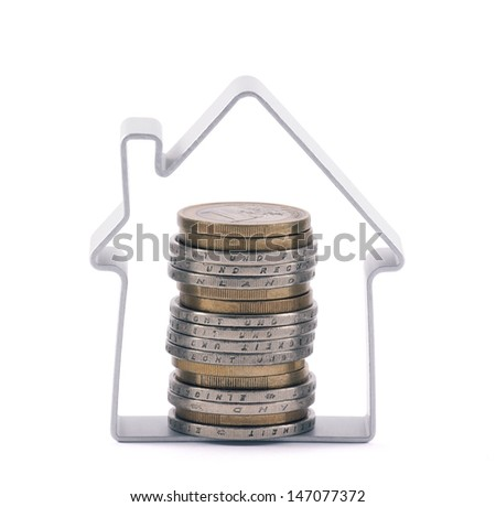 House and stack of euro coins. Clipping path included. - stock photo