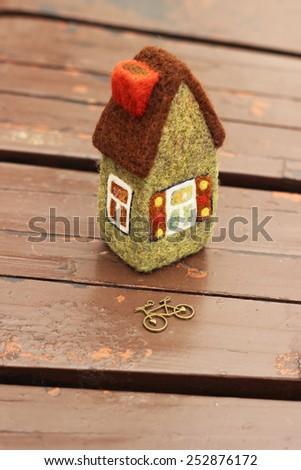 house and toy  metallic bicycle - stock photo