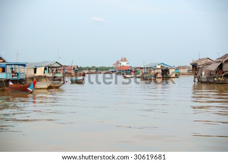 house boat village on the Mekong Vietnamese living in Cambodia - stock photo