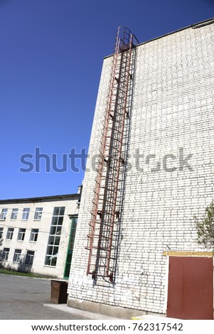 House brick wall with fire escape