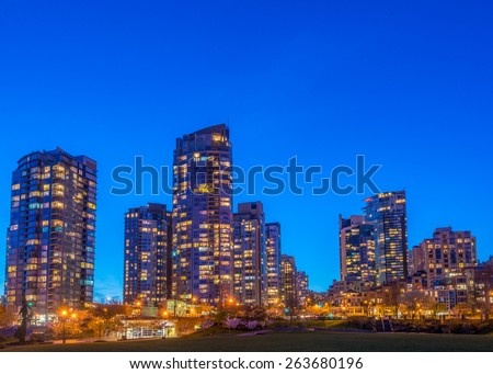 House building and city concept: evening outdoor urban view of modern real estate homes. - stock photo