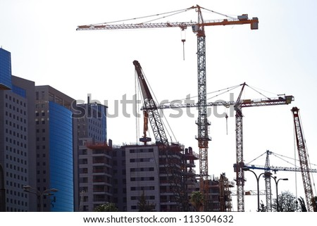 house building and cranes - stock photo