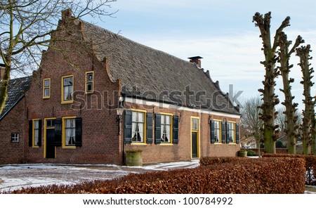 House built in 1759 in winter in Veldhoven, the Netherlands - stock photo