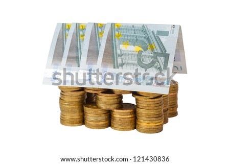house built of coins and banknotes on white background isolated - stock photo