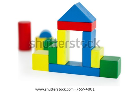 House built out of wooden toy on a white background