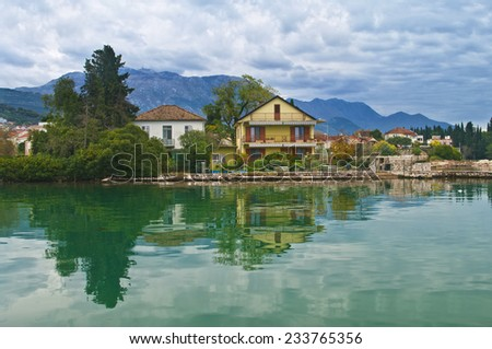 house by sea on cloudy day in Tivat, Montenegro - stock photo