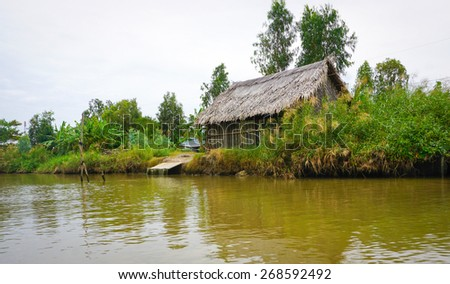 house by the river in Mekong Delta, Vietnam - stock photo