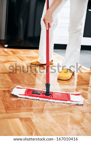 House cleaning -Mopping hardwood floor - stock photo