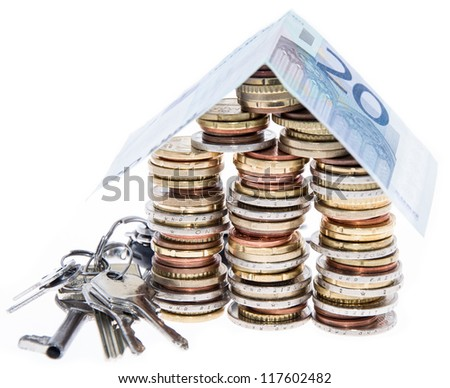 House consisting of Coins isolated on white background - stock photo