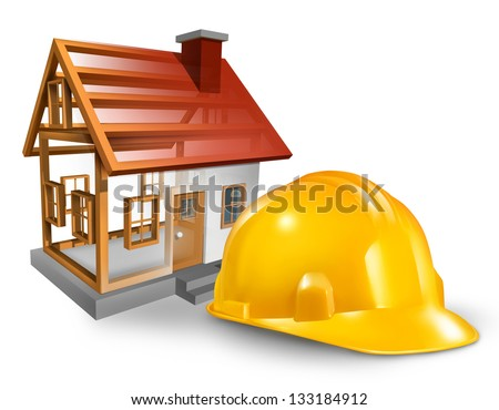 House construction and home builder concept with a yellow worker hardhat and a residential structure being built on a white background. - stock photo