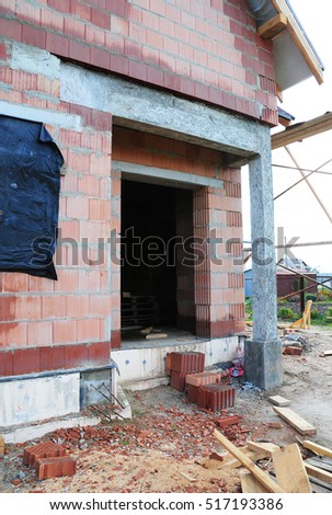 House Construction Entrance. Building Site with New House from Ceramic Porous Blocks.